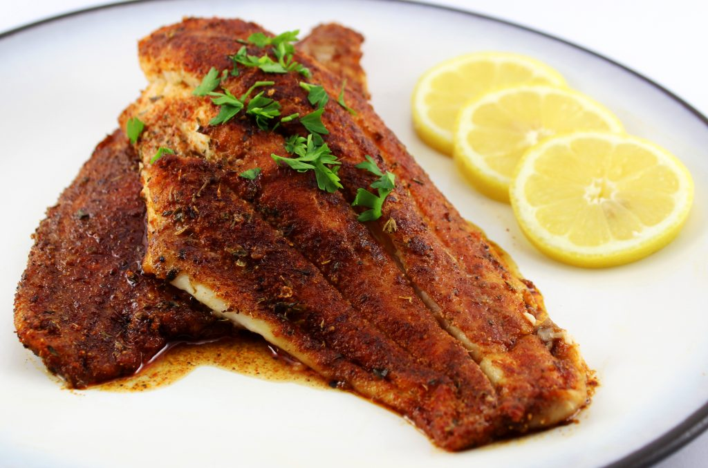 Blackened Catfish is a great alternative to fried catfish! Homemade blackened seasonings and catfish cooked in cast-iron skillet is sure to be a crowd pleaser. Weight Watcher friendly recipe! www.bitesofflavor.com