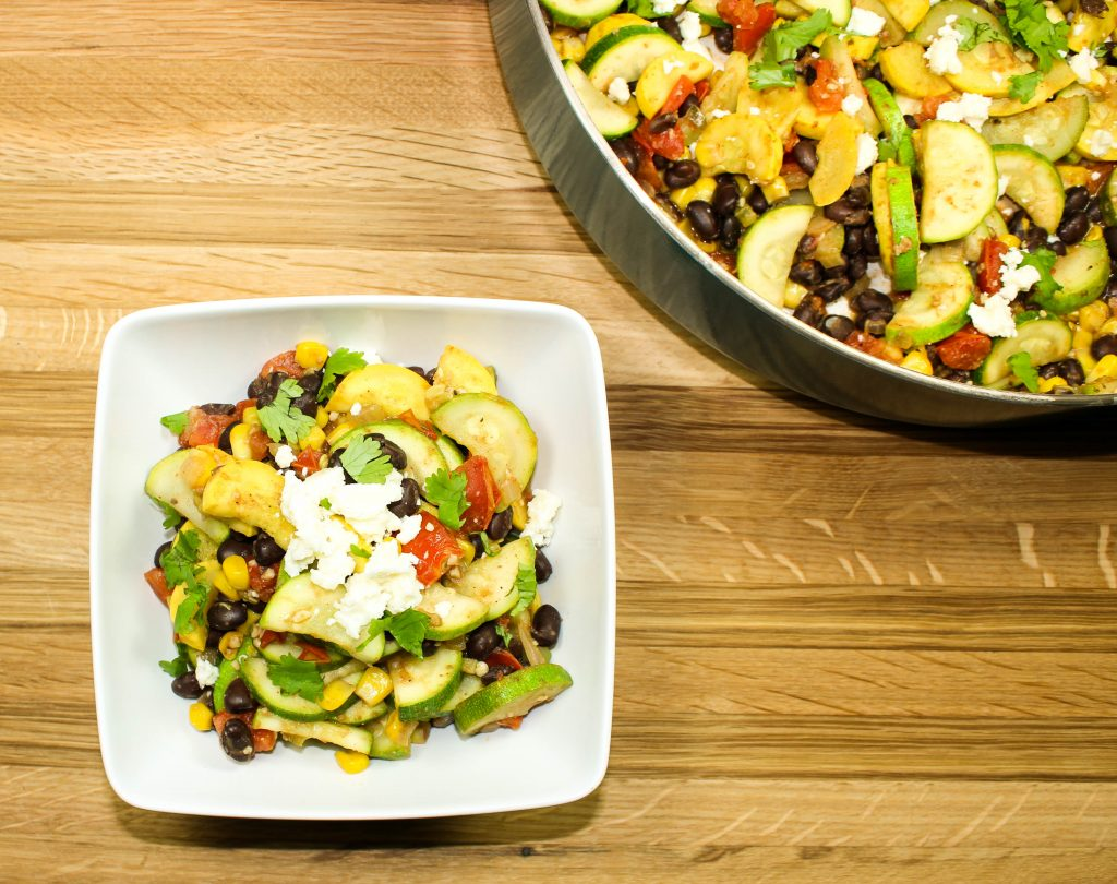 Mexican Zucchini Stir Fry is full of veggies & black beans! Sauteed zucchini, squash, corn, beans, and peppers. Great as side dish or tacos. Weight Watchers friendly recipe! www.bitesofflavor.com