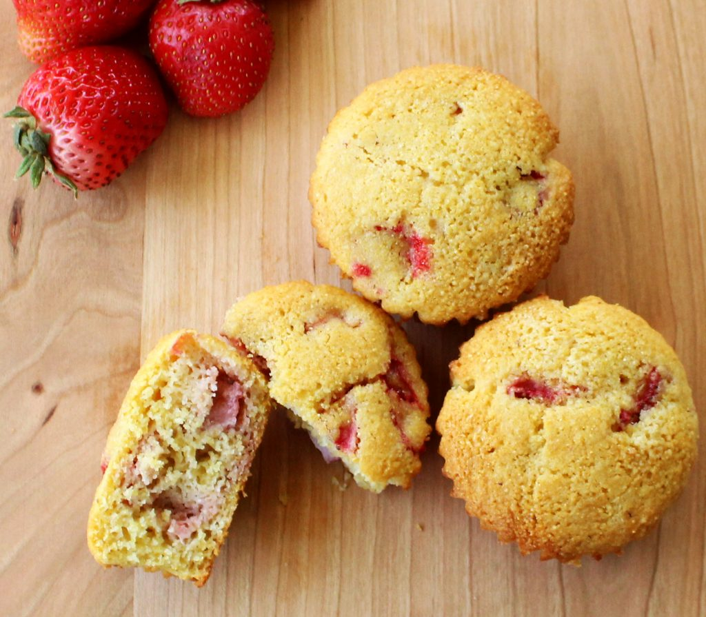 Weight Watcher friendly Strawberry Corn Muffins are filled with fresh strawberries and sweet goodness! Great for a grab and go breakfast. 5 SmartPoints!