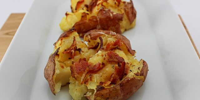Weight Watcher friendly roasted potatoes that are smashed and roasted! Bacon Smashed Roasted Potatoes are a unique spin on classic baked potatoes that are crispy, cheesy, puffy, and healthy. Weight Watchers friendly (6 SmartPoints).