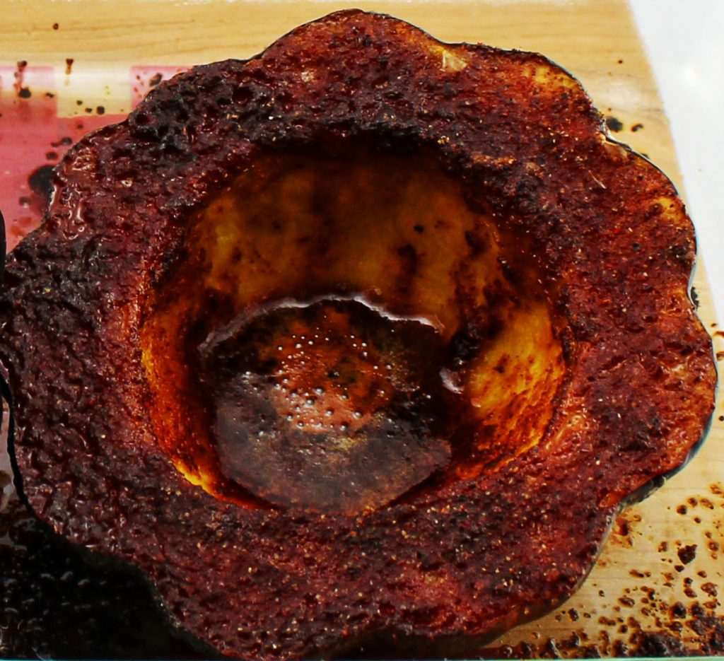Chili Butter Acorn Squash is perfectly baked acorn squash with a decadent sweet and spicy butter sauce is easy to make! Weight Watchers friendly recipe! www.bitesofflavor.com
