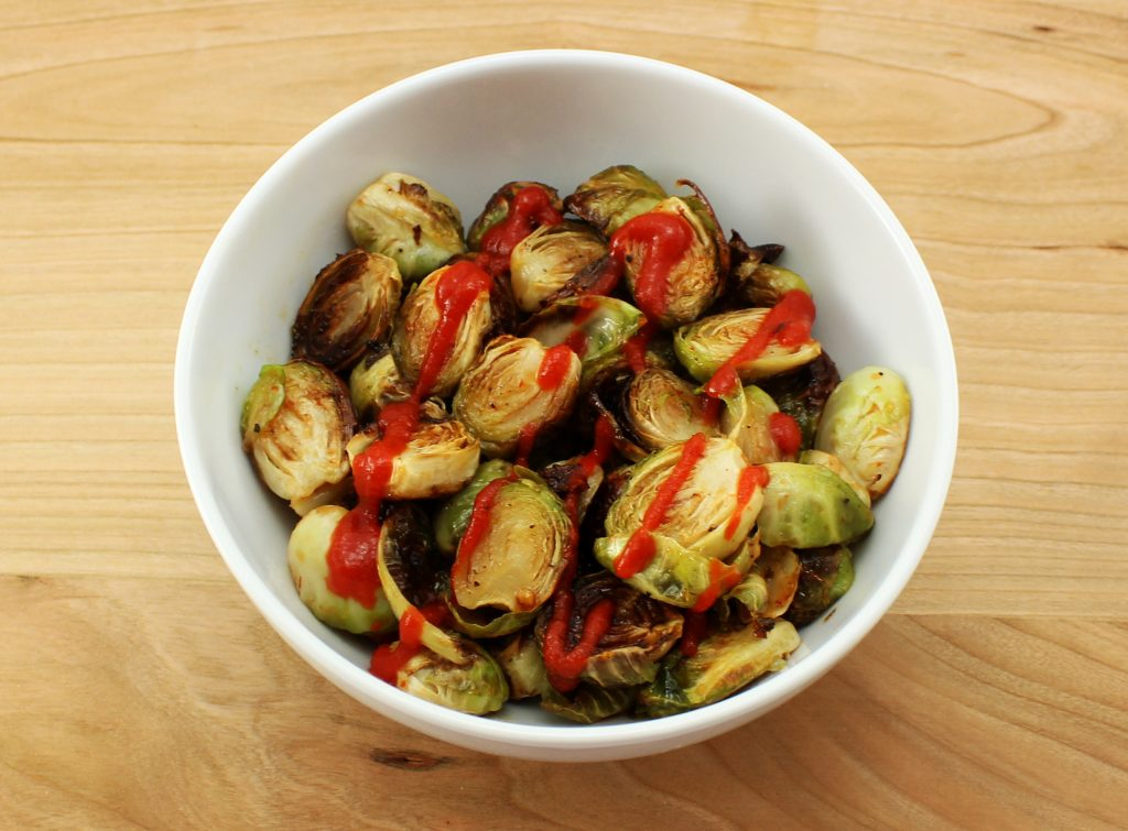 Healthy and full of flavor Sriracha Honey Brussel Sprouts are crispy and coated with a delicious sweet and spicy sauce. Perfect side dish for any meal! Weight Watcher friendly (3 SmartPoints).