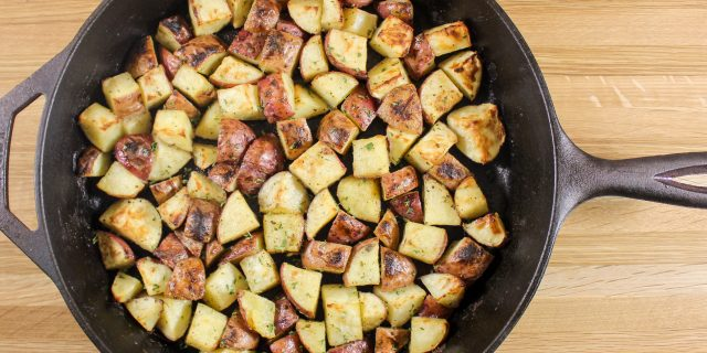 Cast Iron Skillet Ranch Potatoes- unique twist on the classic breakfast skillet potatoes. Baked, crunchy potatoes coated in ranch dressing seasoning. Kid-friendly & a guaranteed repeat recipe for you to make. Weight Watcher friendly and 5 SmartPoints per serving.