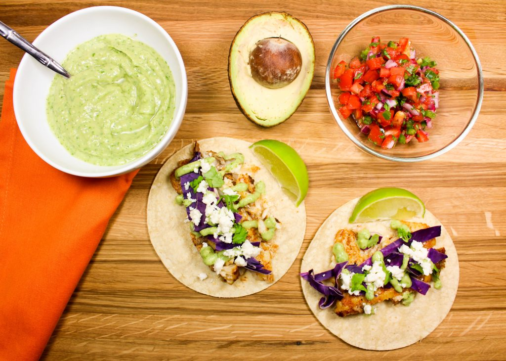 """Skillet Fish Tacos with Avocado Crema are perfect for """"taco Tuesday"""" or really any day of the week! Quick to make, flavorful with every bite, and healthy! 10 SmartPoints for 2 tacos."""