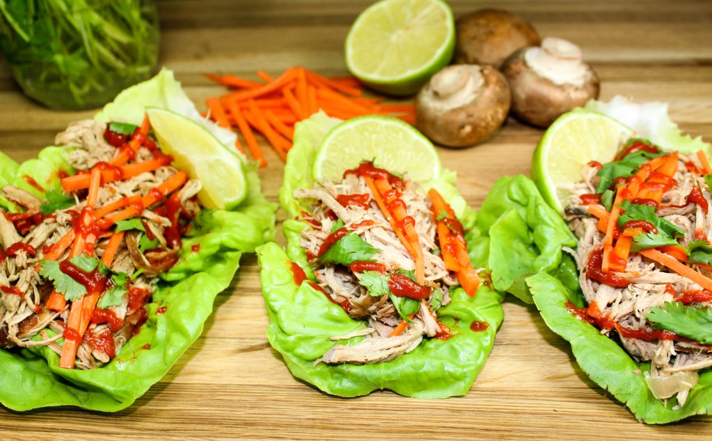 Slow Cooker Asian Pork Lettuce Wraps are the perfect meal when you want a flavorful meal, but don't want all the guilt. Low-carb & low-fat! Make the pork ahead of time & you've got yourself a quick weeknight meal! Weight Watcher friendly and only 6 SmartPoints for two wraps.