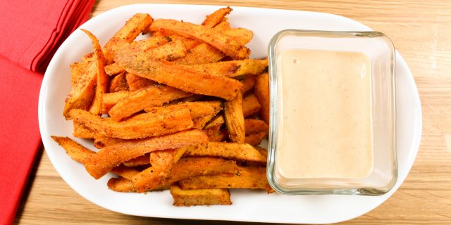 Sweet Potato Fries with Sriracha Cilantro Aioli are sure to satisfy your French fry craving! Baked, spicy potatoes with a fresh, delicious dipping sauce. Perfect side for any dish! 5 SmartPoints.