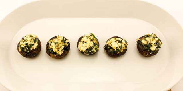 Low-fat and easy to make Feta Spinach Stuffed Mushrooms are the perfect party appetizer or side dish. Mushrooms stuffed with sauted spinach and feta cheese. Weight Watcher friendly (1 SmartPoint).