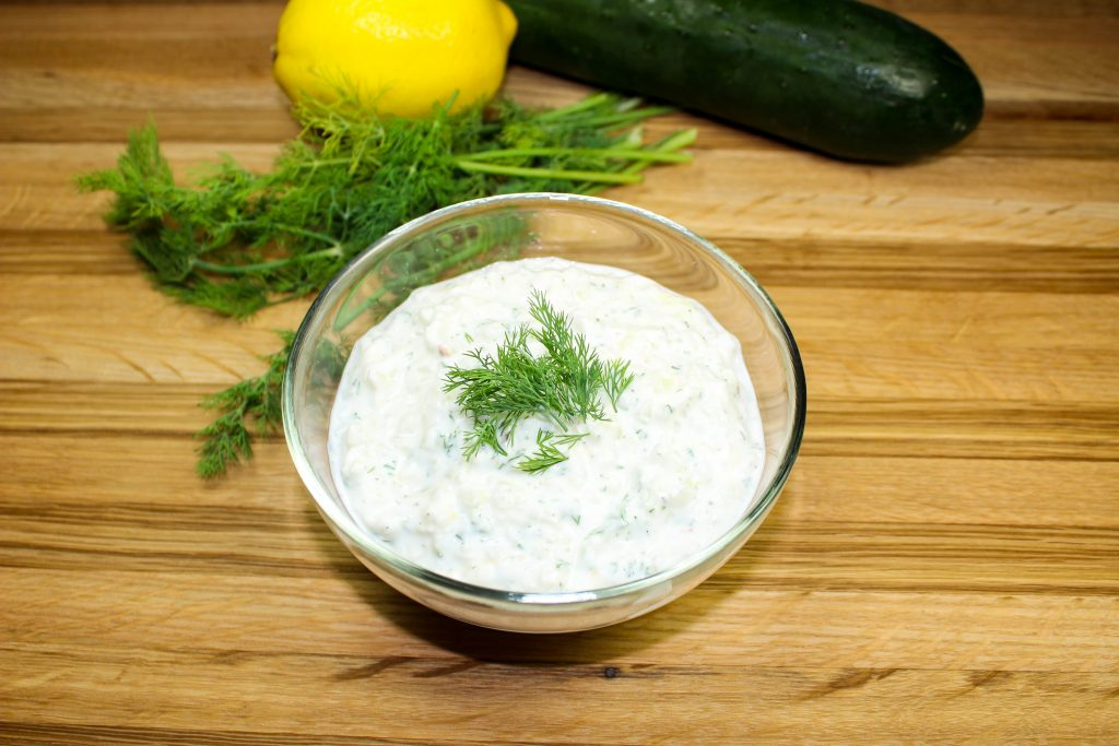 Homemade Tzatziki Sauce is the perfect addition to any Greek inspired meal without the guilt. This cream sauce is low fat and low carb packed with bold flavors. Great as a dip or topped on seasoned grilled meat! Weight Watchers friendly recipe. www.bitesofflavor.com
