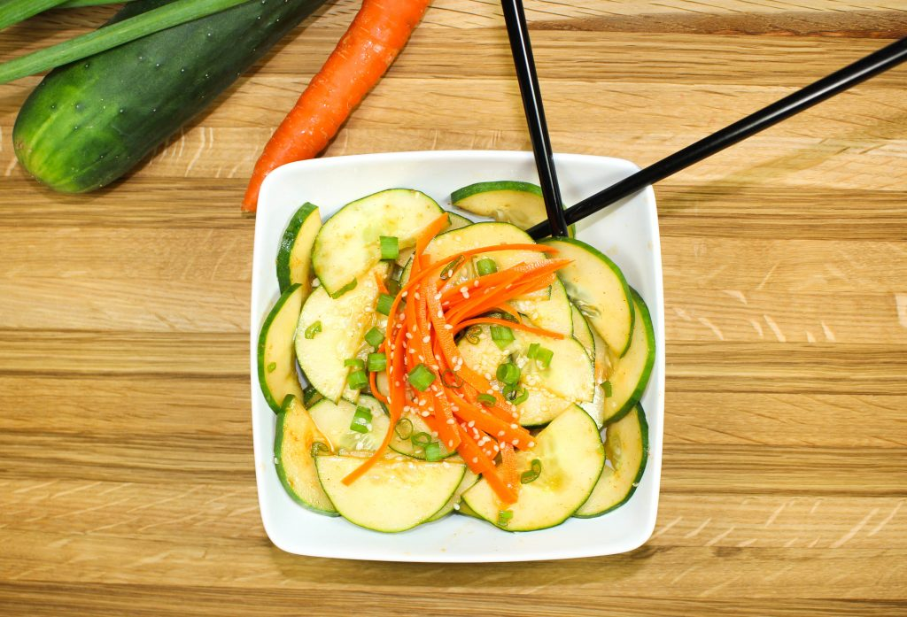Spicy Asian Cucumber Salad is a great side dish or appetizer for any Asian inspired meal. Crisp cucumbers and carrots tossed in a spicy & sweet dressing. Great Asian flavors! Weight Watchers friendly recipe! www.bitesofflavor.com