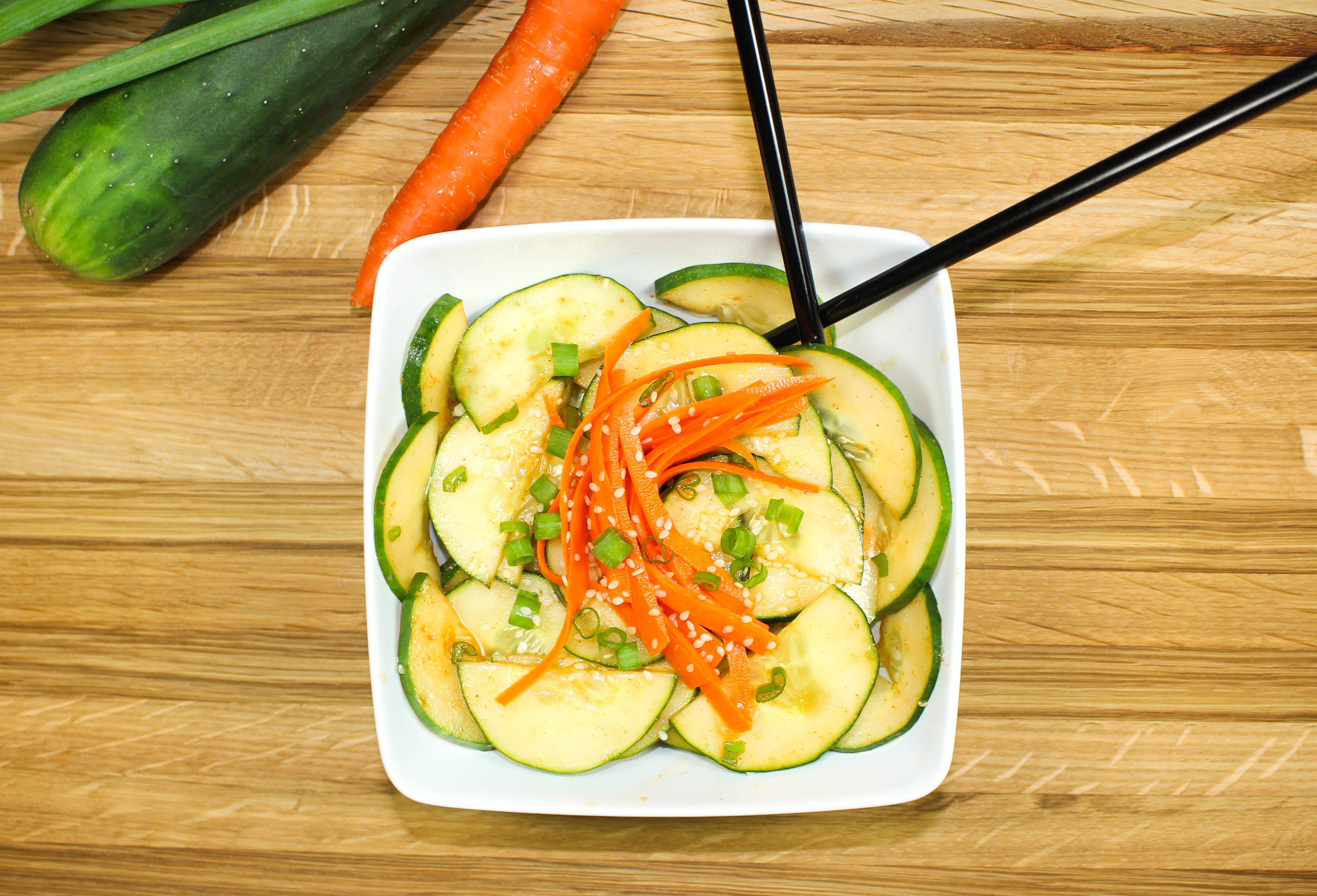 Spicy Asian Cucumber Salad-Great side dish or appetizer for any Asian inspired meal. Crisp cucumbers & carrots tossed in a spicy & sweet dressing. Bold flavors, quick to make, & healthy! Low fat & low calorie. Weight Watcher friendly (2 SmartPoints)!