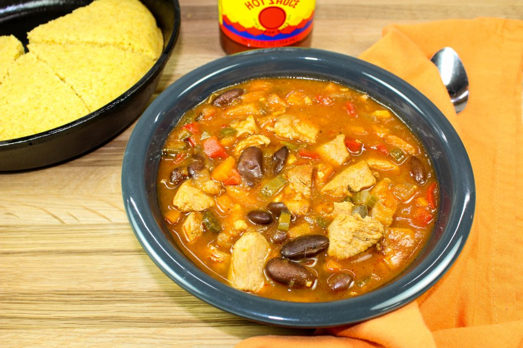 Cajun Bean & Chicken Stew- Cajun comfort in a bowl. Delicious chicken breast, red kidney beans, and Cajun spices served over rice make for the perfect combination of flavors. Hearty, just the right heat, & healthy! Weight Watcher friendly recipe. www.bitesofflavor.com