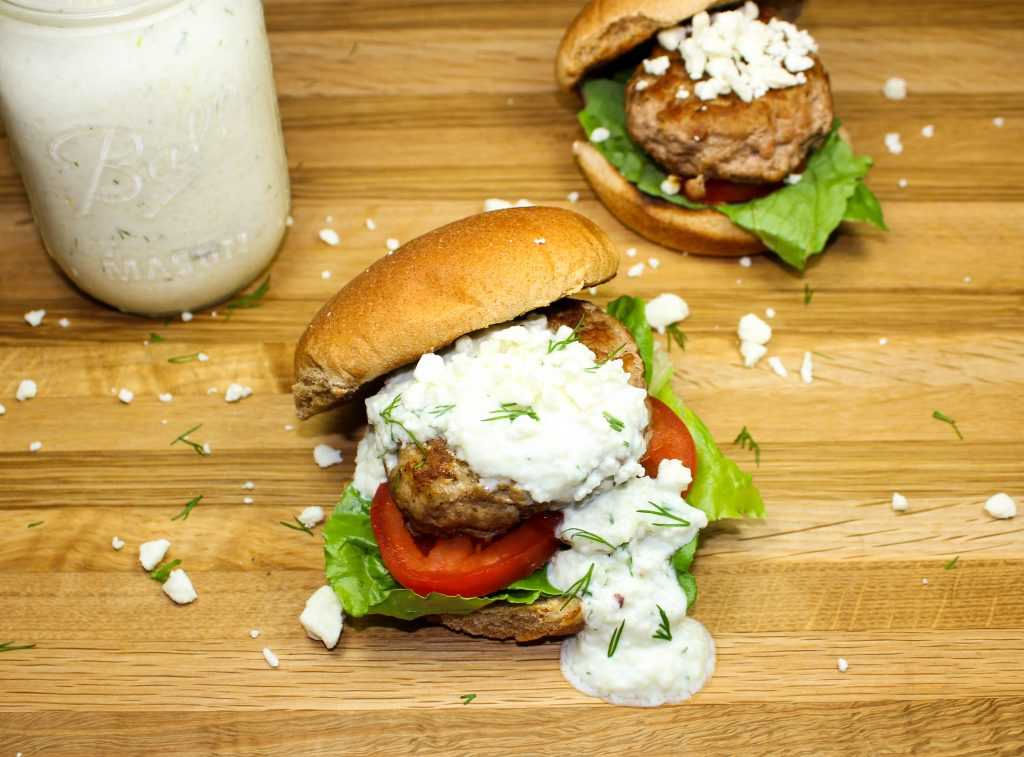 Greek Turkey Burgers are perfect for burger night at home. Quick to make, packed with spices, and healthy. Delicious Greek inspired burger! Weight Watchers friendly recipe! www.bitesofflavor.com