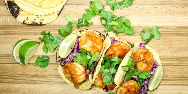 Sweet & Spicy Asian Shrimp Tacos-Perfect for a quick weeknight meal. Sweet chili sauce toss in shrimp, wrapped in a tortilla & topped with cabbage. Asian flavors turned into tacos are sure to please a crowd. Weight Watcher friendly (7 SmartPoints).