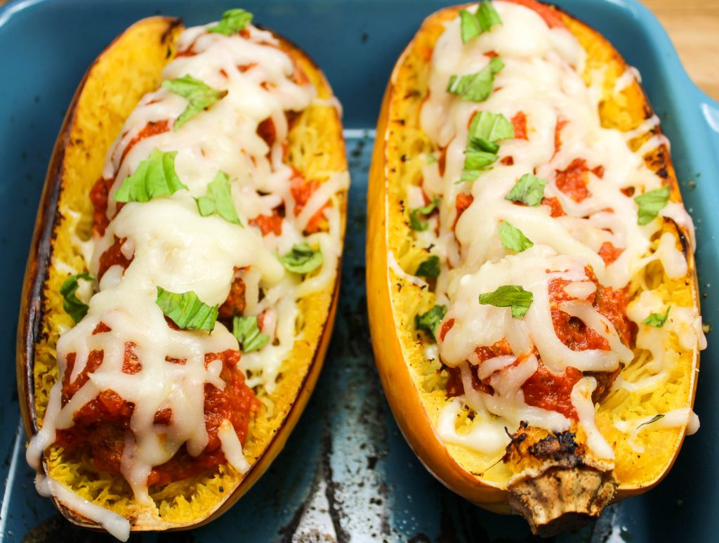 Meatball Stuffed Spaghetti Squash is juicy meatballs, stuffed in spaghetti squash, topped with fresh marinara sauce and cheese. Comfort food lightened up! Weight Watchers friendly recipe. www.bitesofflavor.com