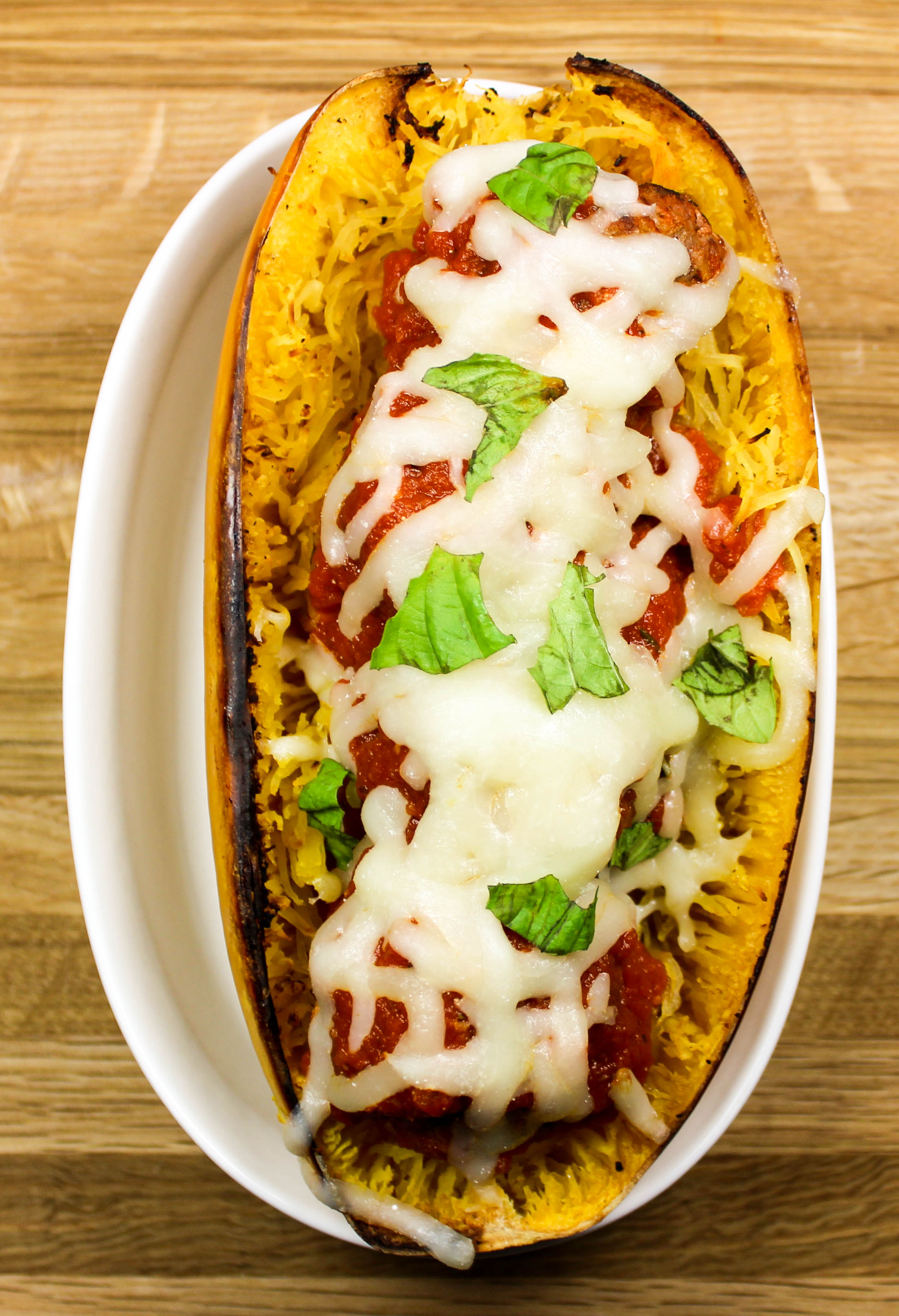 Meatball Stuffed Spaghetti Squash is spaghetti and meatballs without the guilt. Juicy meatballs, stuffed in spaghetti squash, topped with fresh marinara sauce and cheese. Weight Watchers friendly recipe. www.bitesofflavor.com