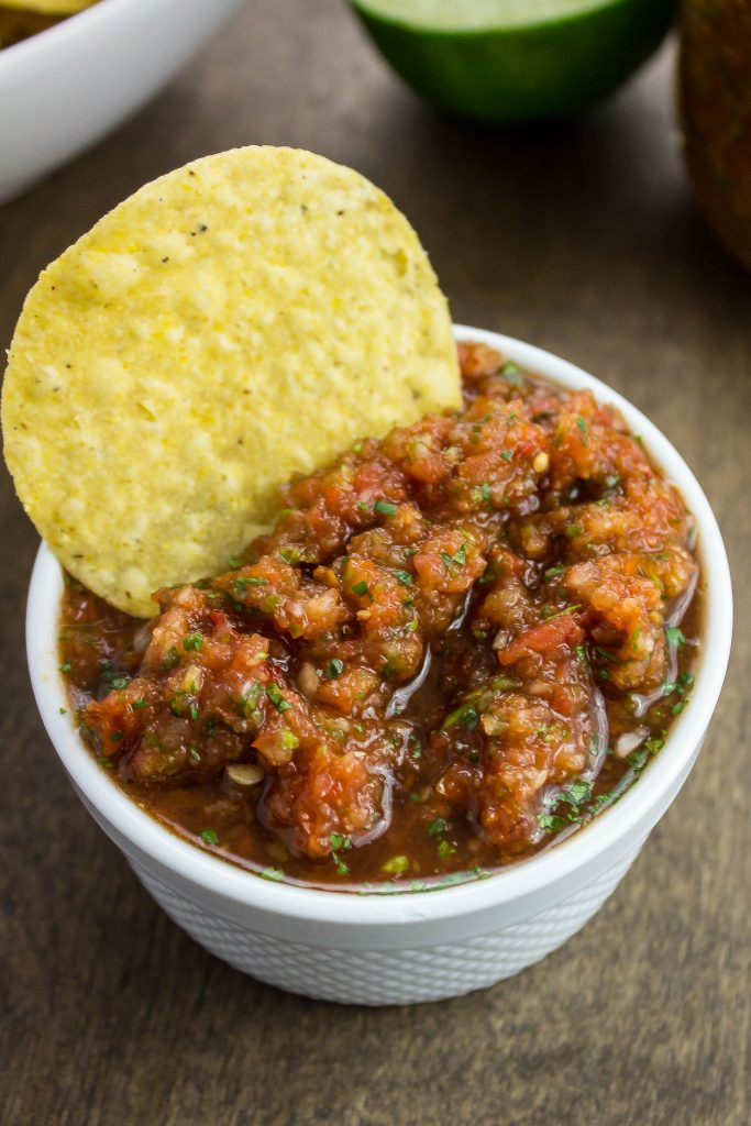 Quick & Easy Tomato Chipotle Salsa is fresh tomatoes, cilantro, onion, and peppers mixed in a blender for a quick and easy homemade salsa.  Weight Watchers friendly recipe!  www.bitesofflavor.com