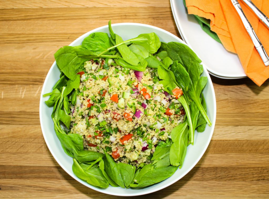 Quinoa Tabbouleh Spinach Salad-Light yet filling salad great for lunch or dinner.  Fresh vegetables, quinoa & baby spinach, topped with a vinaigrette is sure to please any non-salad lover.  Great for make ahead meal.  Weight Watchers friendly recipe.  www.bitesofflavor.com