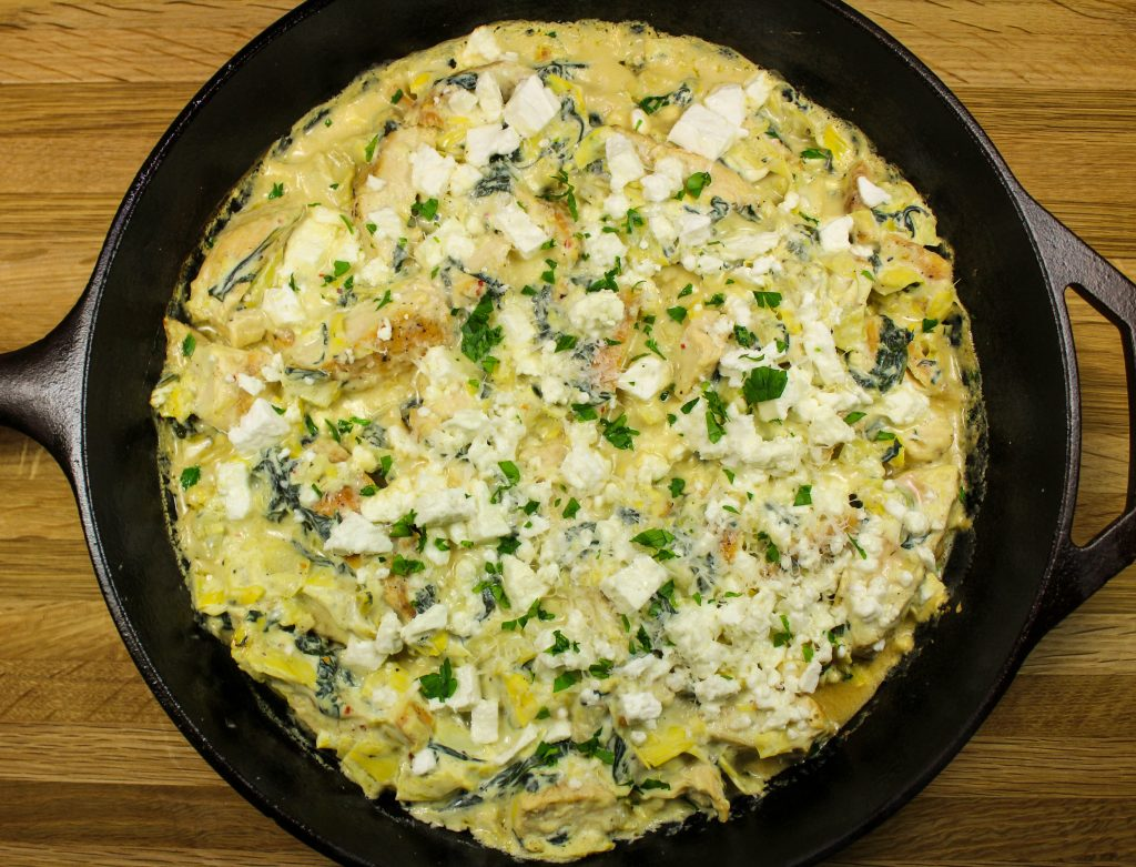 Skillet Spinach Artichoke Chicken- Spinach Artichoke Dip turned into a healthy dinner! Cheese sauce mixed with spinach, artichokes, & chicken baked until bubbly is heaven in a bite. Great for a quick weeknight meal. Packed with flavor yet healthy & low-carb. Weight Watcher friendly (8 SmartPoints).
