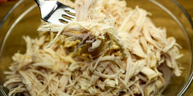 Slow Cooker Shredded Chicken- Easiest & most flavorful way to make shredded chicken. Chicken breast cooked in broth makes for delicious, moist shredded chicken. Versatile & a staple for any meal. Freezer friendly! Weight Watchers friendly (2 SmartPoints).