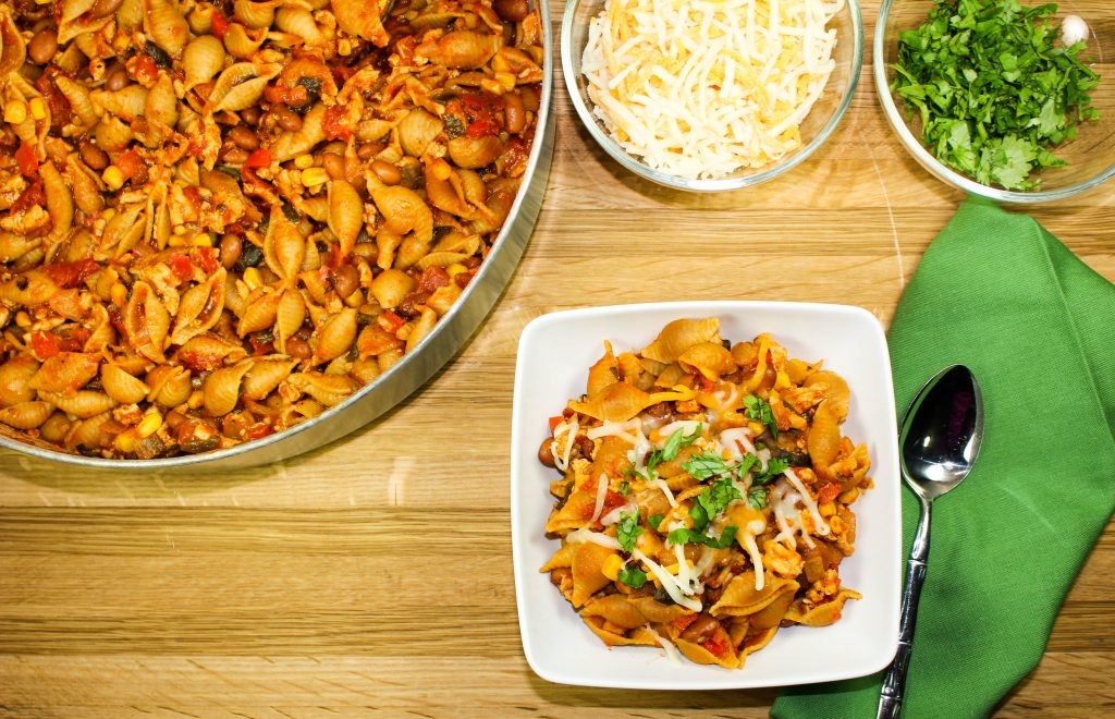 Stove Top Turkey Chili & Shells-Perfect blend of chili & pasta. Spicy ground turkey, roasted vegetables, pasta shells, topped with cheese. Made on the stovetop in less than an hour for a great weeknight meal! Weight Watcher friendly (8 SmartPoints).