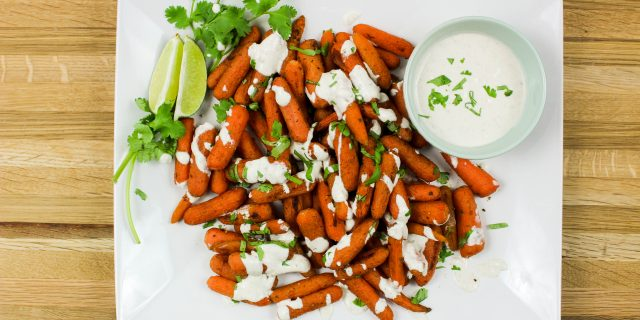 Indian Spiced Carrots with Curry Sauce- Roasted carrots coated in Indian spices and served with a creamy curry sauce. Weight Watcher friendly! www.bitesofflavor.com
