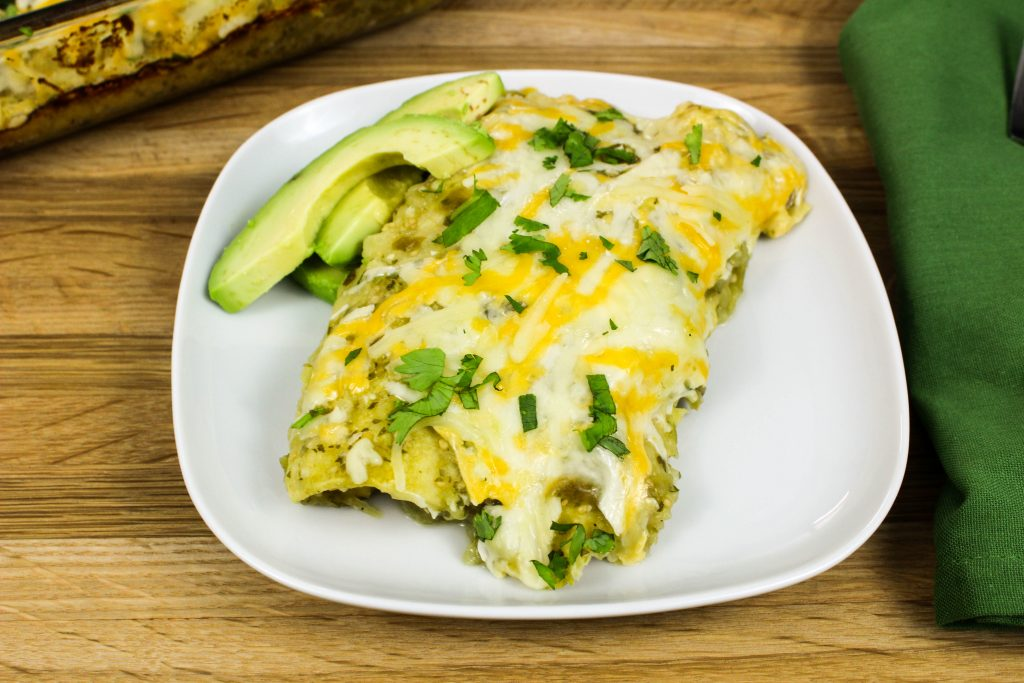 Roasted Tomatillo Vegetable Enchiladas are roasted vegetables stuffed in tortillas, coated in fresh tomatillo salsa & topped with cheese is heaven in each bite! Weight Watchers friendly recipe. www.bitesofflavor.com