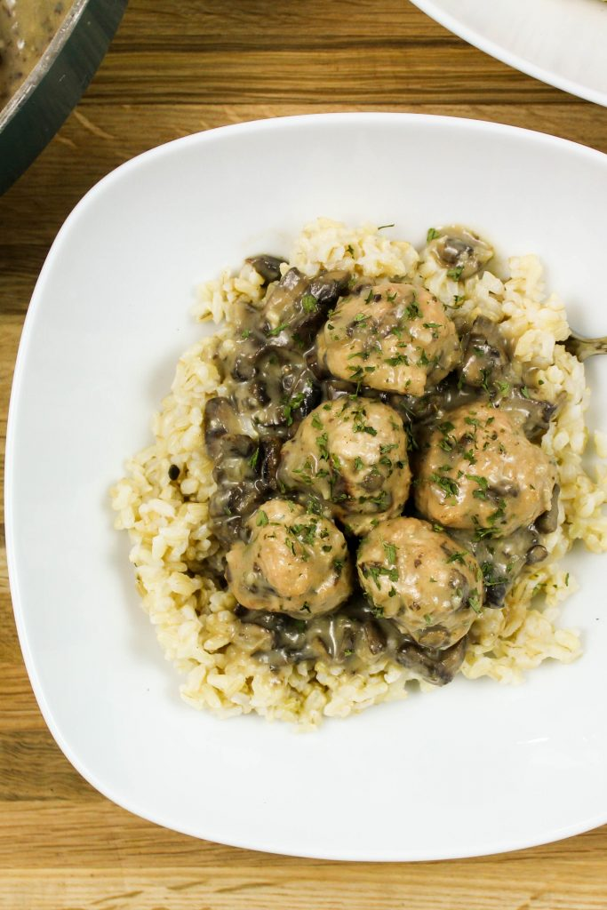 Turkey Meatballs in Creamy Mushroom Gravy is flavorful turkey meatballs cooked in creamy mushroom gravy served over rice. Weight Watchers friendly recipe. www.bitesofflavor.com