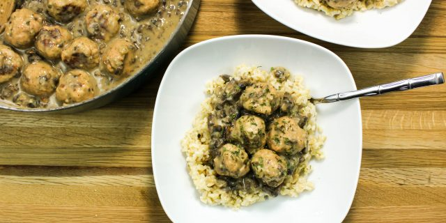 Turkey Meatballs in Creamy Mushroom Gravy- Flavorful turkey meatballs cooked in creamy mushroom gravy served over rice. Weight Watcher friendly. www.bitesofflavor.com