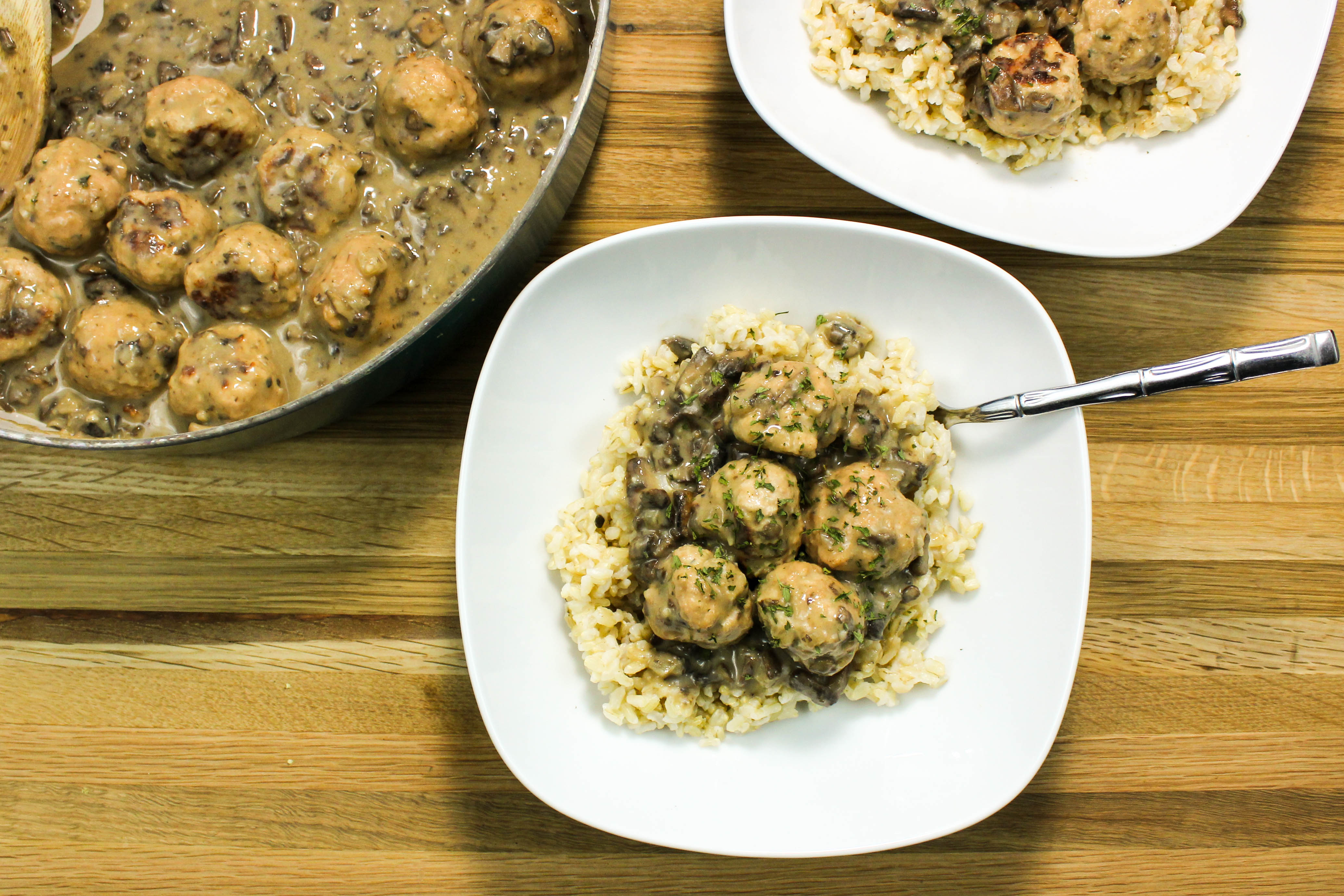 Turkey Meatballs in Creamy Mushroom Gravy- Flavorful turkey meatballs cooked in creamy mushroom gravy served over rice. Weight Watcher friendly. www.bitesofflavor.com