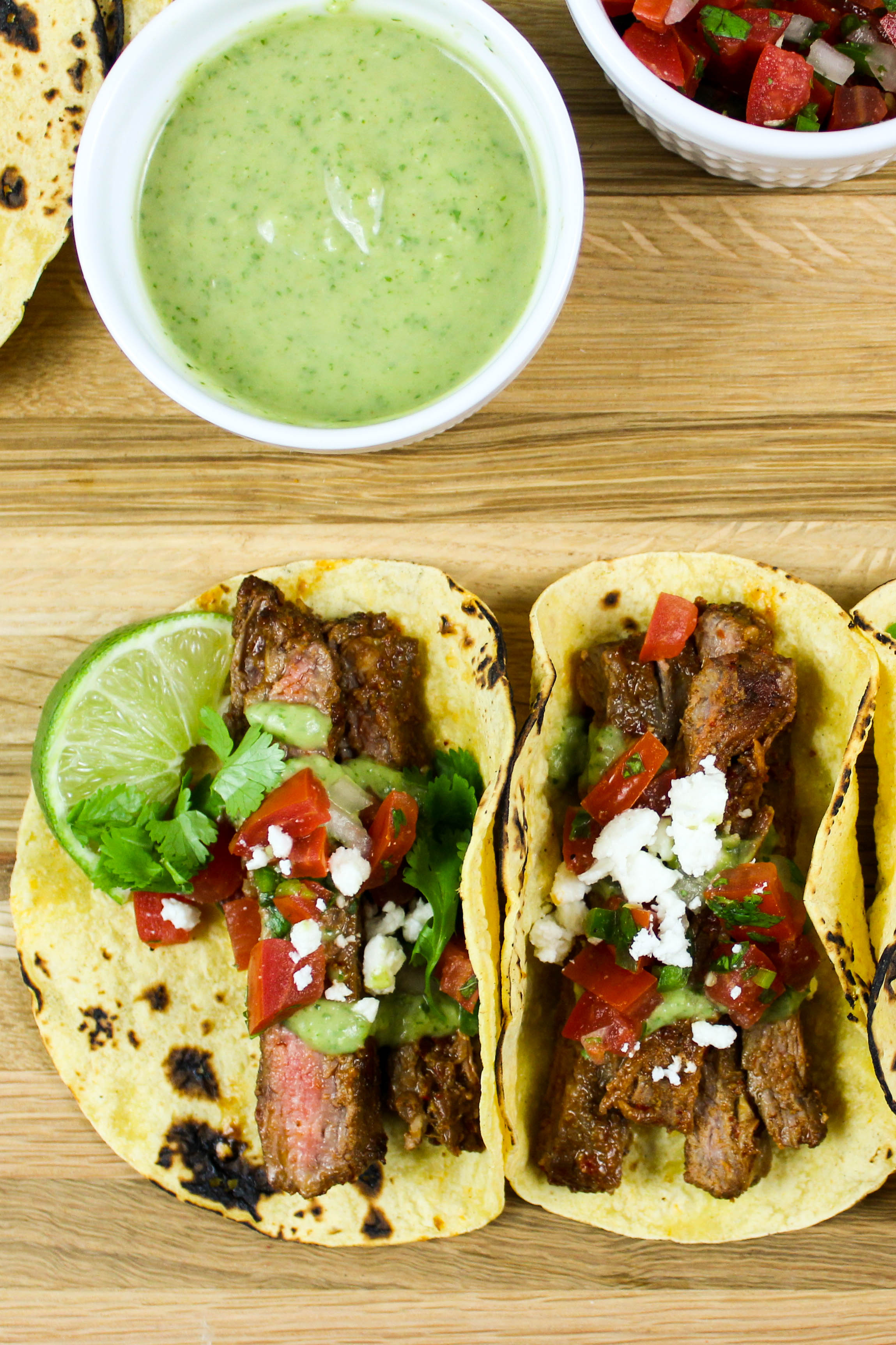 Carne Asada Tacos with Avocado Crema is marinated steak grilled to perfection served in a tortilla & topped with fresh Pico de Gallo & Avocado Crema. Weight Watchers friendly recipe! www.bitesofflavor.com