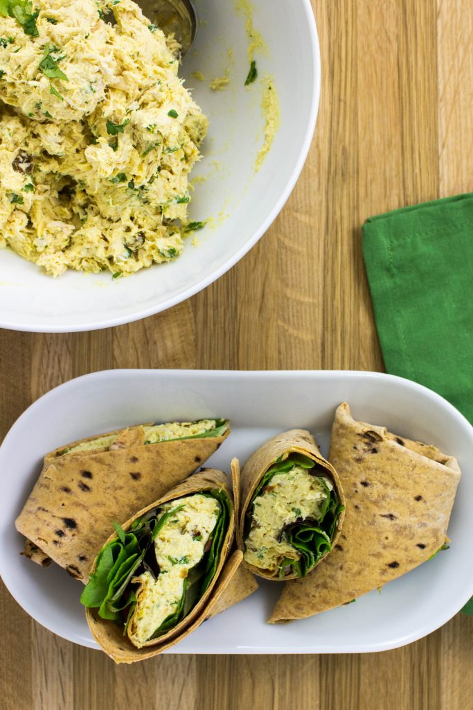 Curry Chicken Salad Wrap- Perfectly cooked shredded chicken mixed with a curry yogurt sauce, toasted almonds, & golden raisins wrapped in a wheat wrap make for a great lunch! Weight Watchers friendly. www.bitesofflavor.com