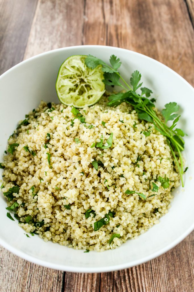 Cilantro Lime Quinoa is the perfect addition to a burrito bowl or as a side for any dish! Fluffy quinoa mixed with fresh cilantro and lime juice is light, zesty, and full of flavor. Weight Watchers friendly recipe. www.bitesofflavor.com