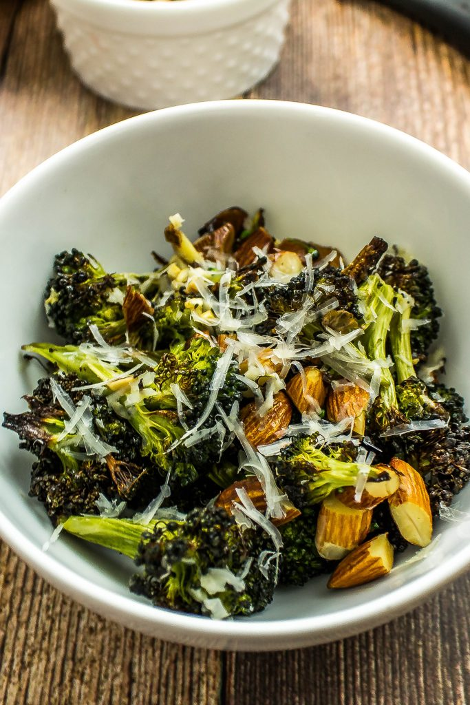 Parmesan Roasted Broccoli- Broccoli & almonds roasted to perfection with lemon juice & topped with shredded parmesan cheese is delicious with every bite! Weight Watchers friendly. www.bitesofflavor.com