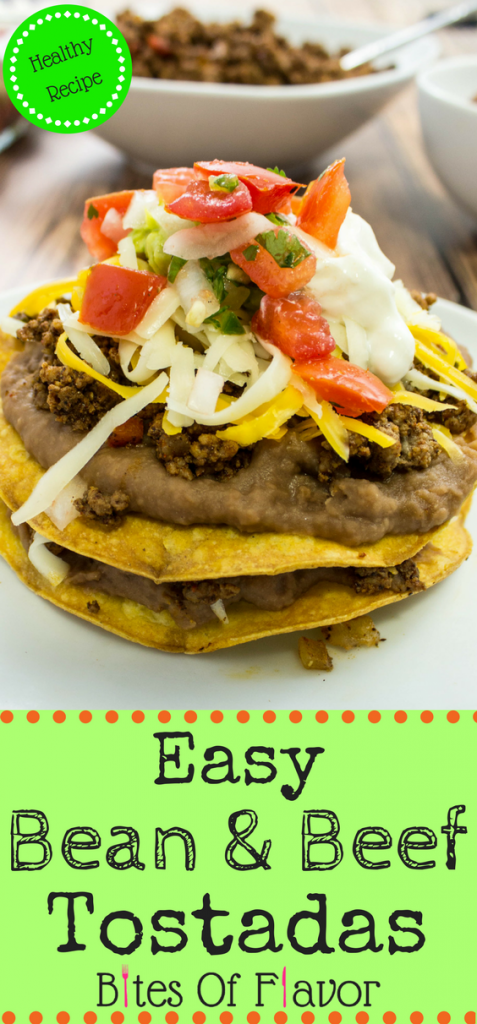 Easy Bean & Beef Tostadas-Taco spiced ground beef & refried beans layered on top of a crispy tortilla topped with cheese & fresh pico de gallo. Weight Watchers friendly recipe. www.bitesofflavor.com