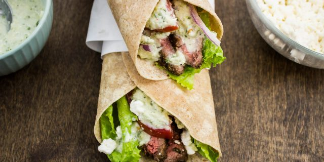 Steak Gyro Wraps-Seasoned grilled steak topped with tzatziki sauce, tomato, onion, lettuce, & feta cheese all wrapped up in a whole wheat wrap. Weight Watchers friendly. www.bitesofflavor.com