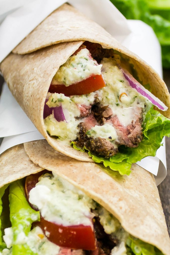 Steak Gyro Wraps is seasoned grilled steak topped with tzatziki sauce, tomato, onion, lettuce, & feta cheese all wrapped up in a whole wheat wrap. Weight Watchers friendly. www.bitesofflavor.com