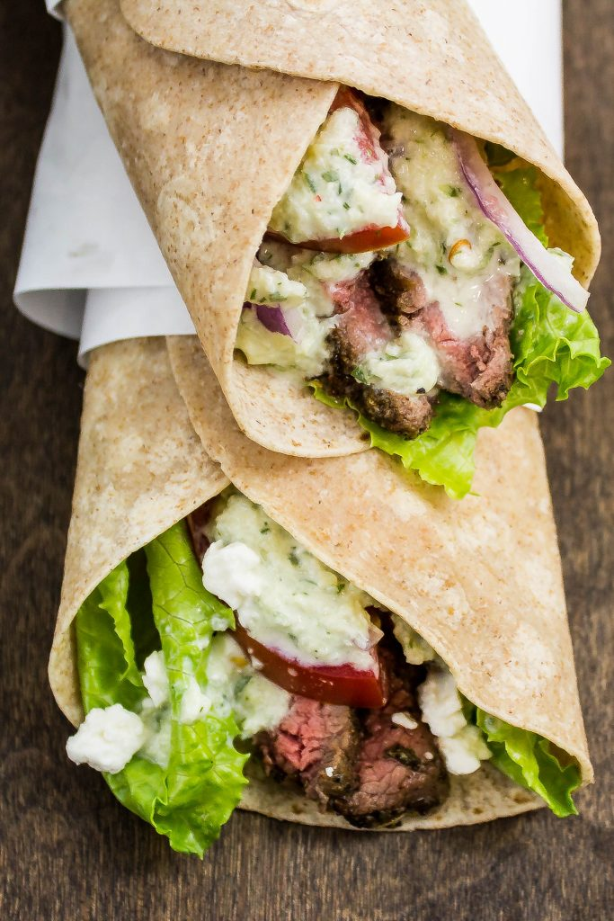 Steak Gyro Wraps are delicious seasoned grilled steak topped with tzatziki sauce, tomato, onion, lettuce, & feta cheese all wrapped up in a whole wheat wrap. Weight Watchers friendly recipe. www.bitesofflavor.com