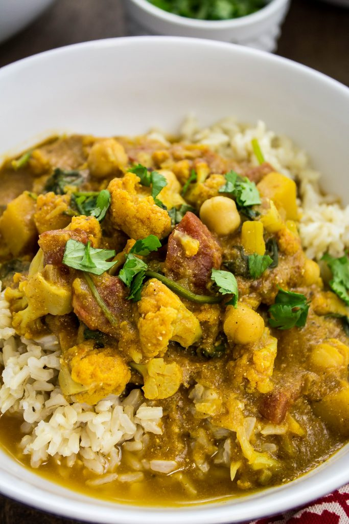 Squash & Vegetable Curry is a hearty dish packed with delicious Indian spices and vegetables. Weight Watchers friendly recipe! www.bitesofflavor.com