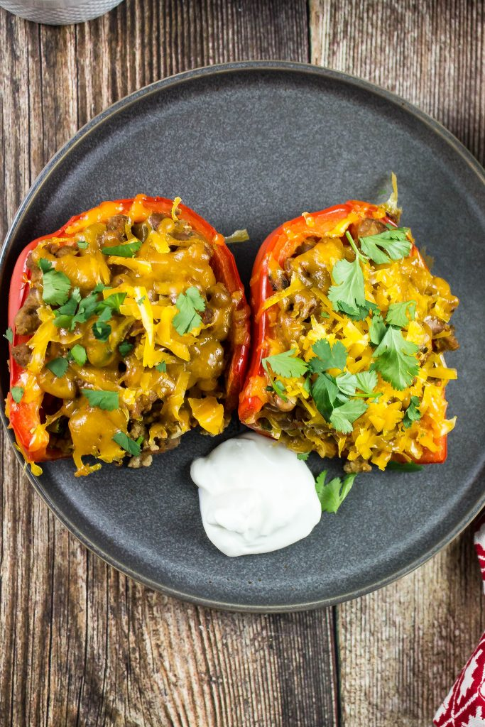 Taco seasoned lean ground turkey and pinto beans stuffed into red bell peppers, baked and topped with cheese.