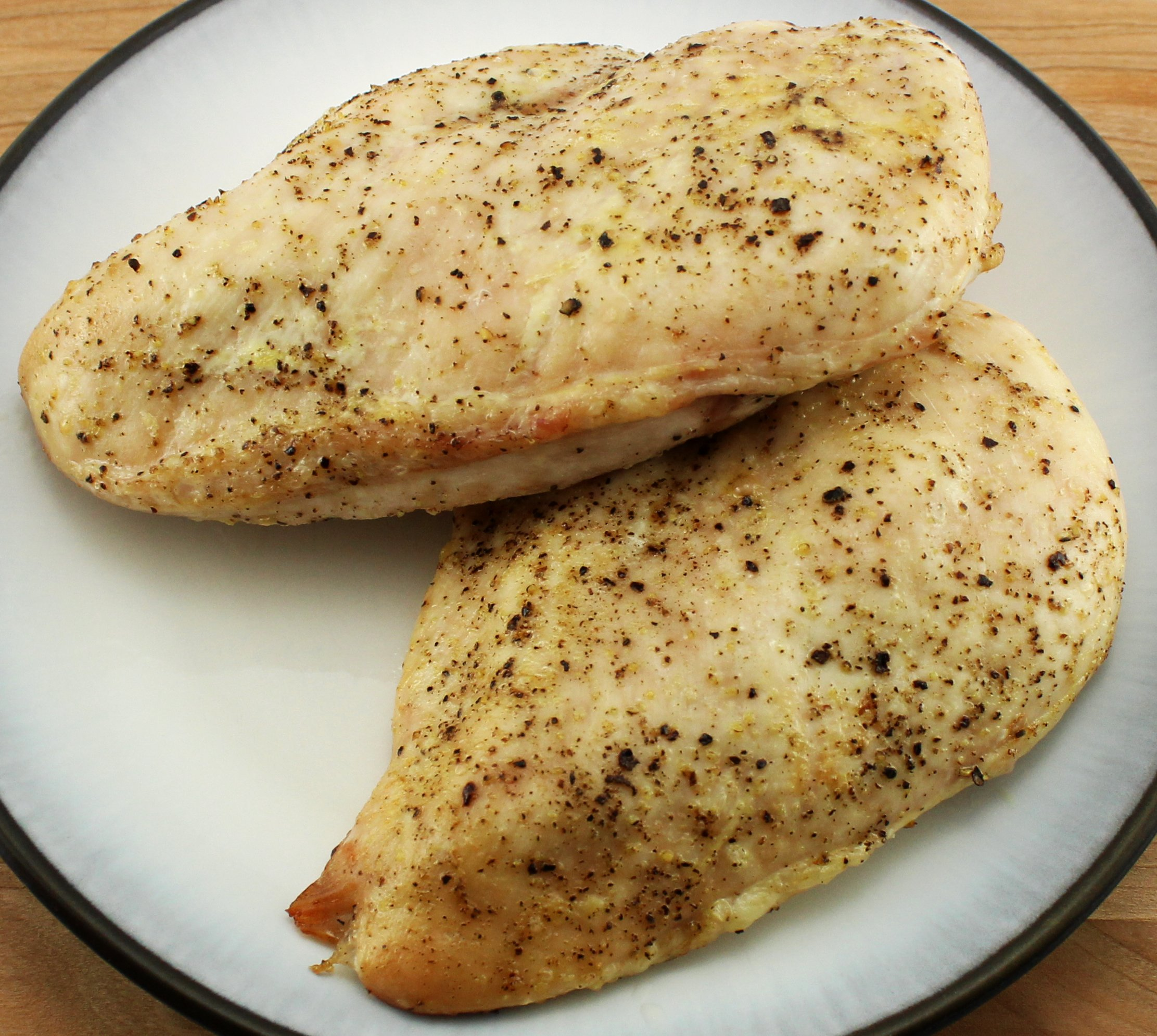 Oven roasted chicken breast on a plate