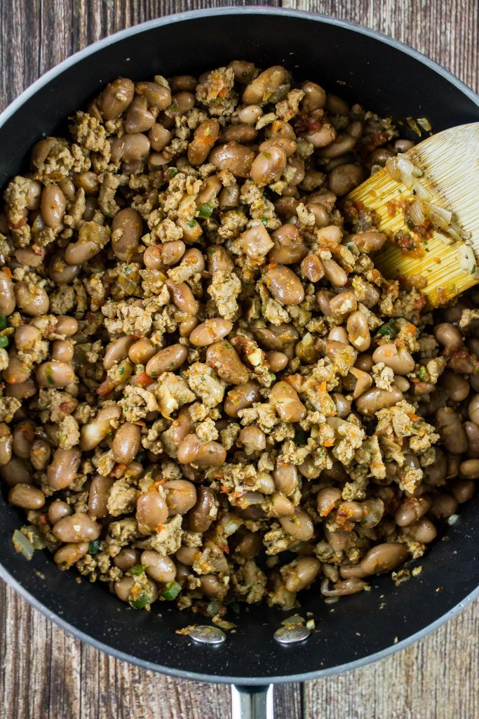 Ground turkey and pinto beans in a skillet