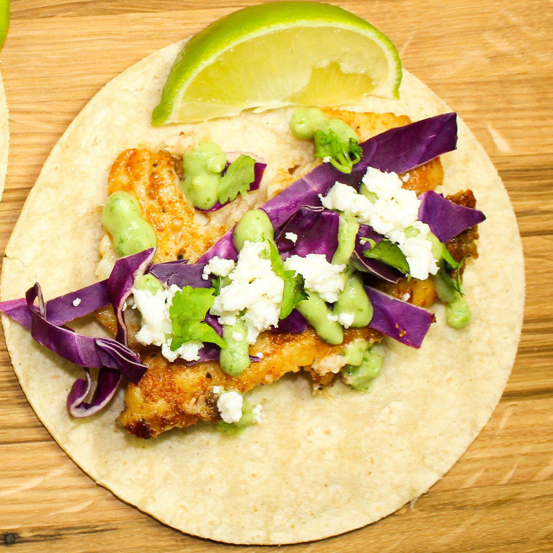 """Skillet Fish Tacos with Avocado Crema are perfect for """"taco Tuesday"""" or really any day of the week. Weight Watchers friendly recipe. www.bitesofflavor.com"""