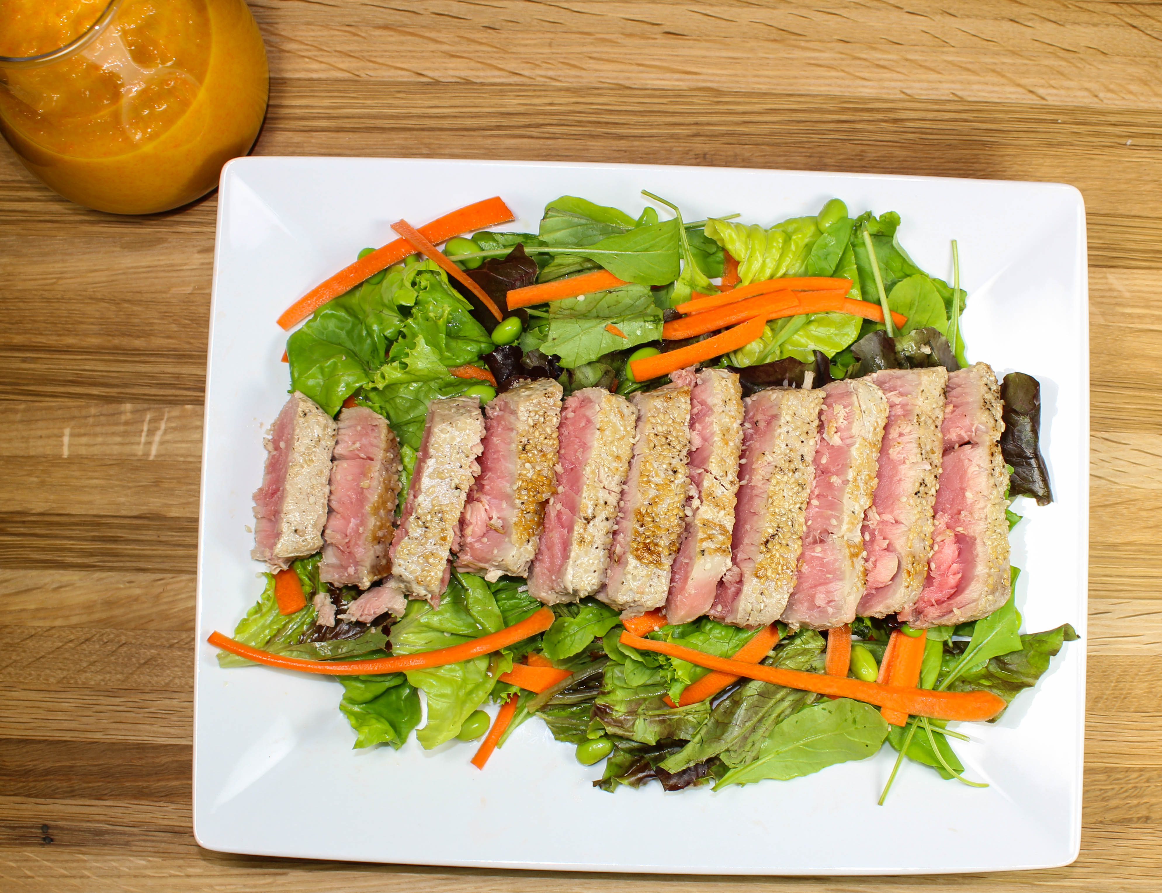 Sesame Ahi Tuna Salad is a great quick weeknight meal when you want to eat a hearty salad and enjoy a restaurant style meal at home. This salad is packed with fresh ingredients and can be made in under 30 minutes!