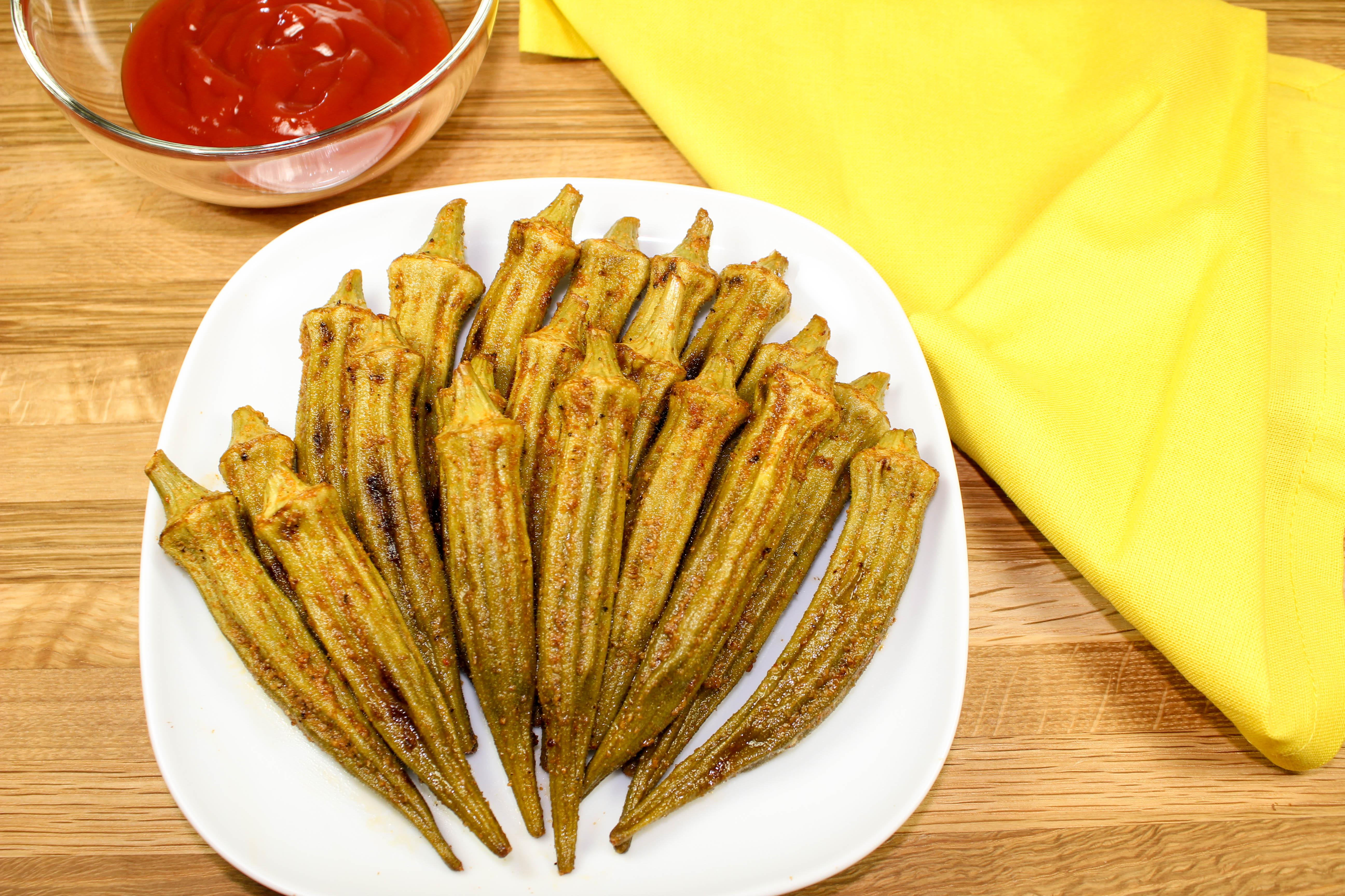 Cajun Baked Okra is packed with Cajun seasonings, crispy, and easy to make. Healthy alternative to fried okra! Weight Watchers friendly recipe. www.bitesofflavor.com