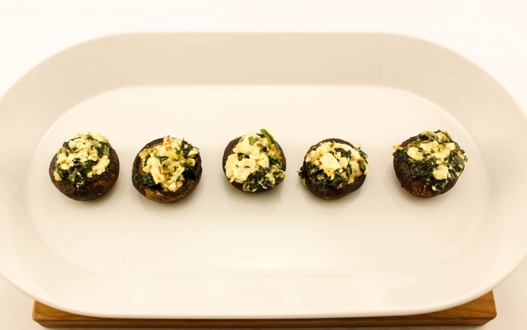 Mushrooms stuffed with sautéed spinach and feta cheese.
