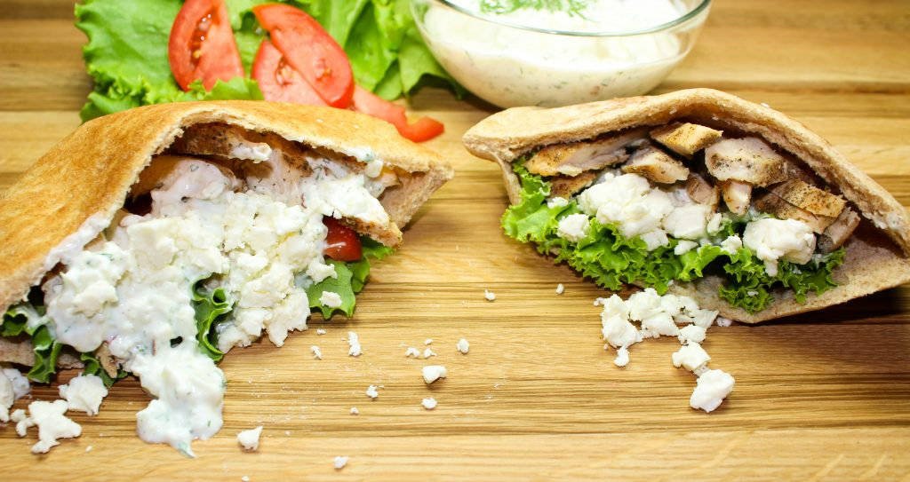 Greek seasoned chicken, wrapped in a whole wheat pita pocket and topped with Homemade Tzatziki Sauce. Great for a quick weeknight meal or for week day lunches! Weight Watchers friendly recipe. www.bitesofflavor.com