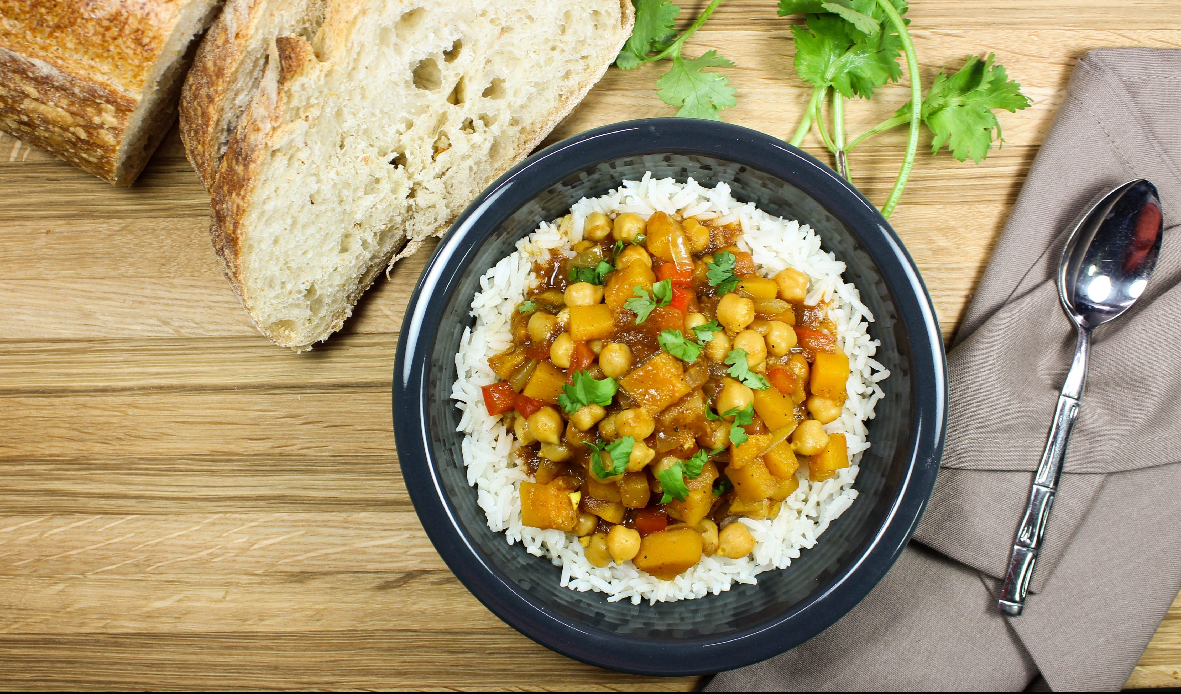 Indian Chickpea Stew-Unique twist on vegetable stew! Delicious Indian spices mixed with hearty vegetables is comfort in a bowl. Great for anyone who is a beginner to Indian food! Spices are sweet with just a hint of spice. Weight Watchers friendly recipe. www.bitesofflavor.com
