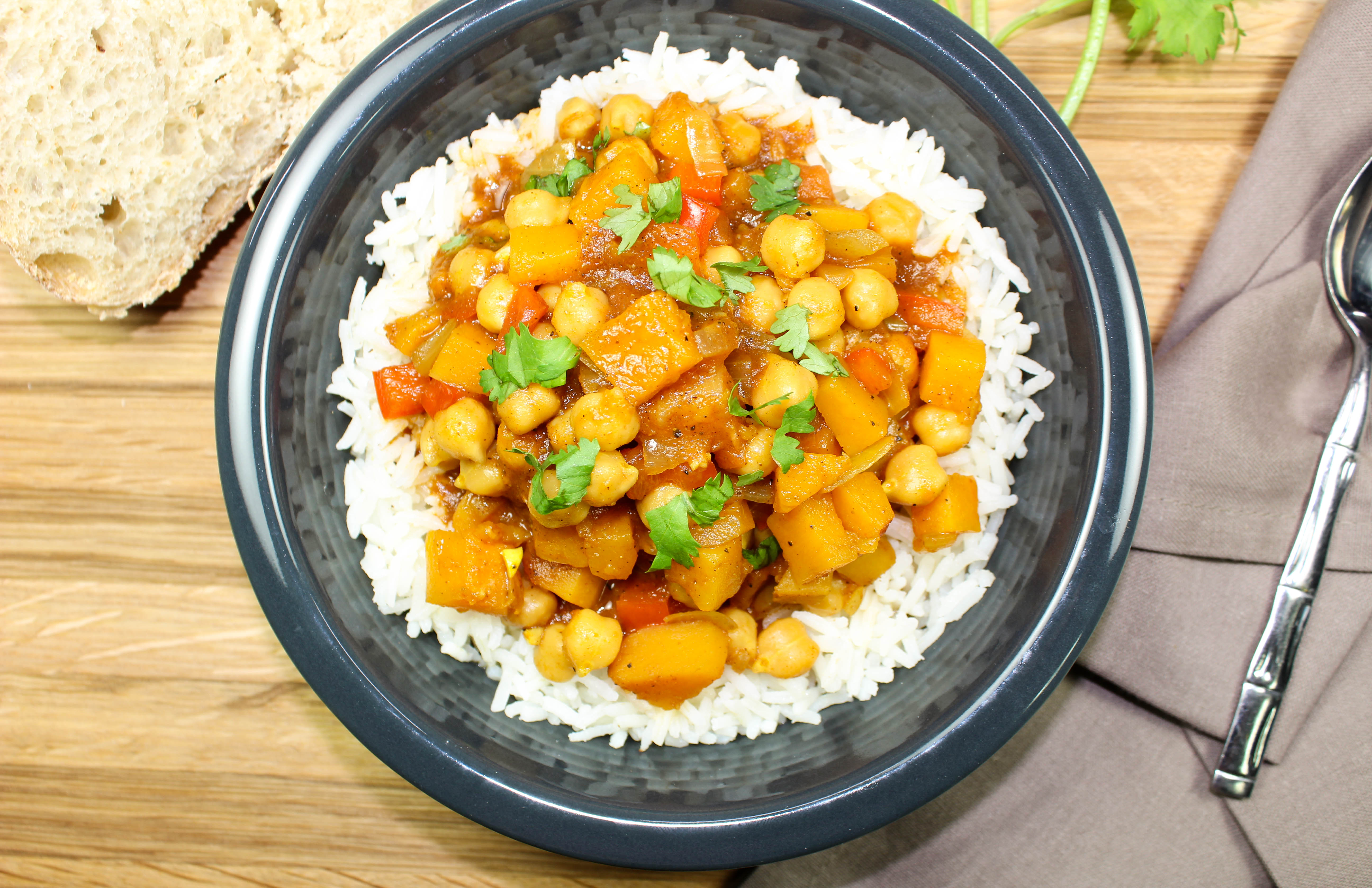 Indian Chickpea Stew-Unique twist on vegetable stew! Delicious Indian spices mixed with hearty vegetables is comfort in a bowl. Great for anyone who is a beginner to Indian food! Spices are sweet with just a hint of spice. Weight Watcher friendly (6 SmartPoints).