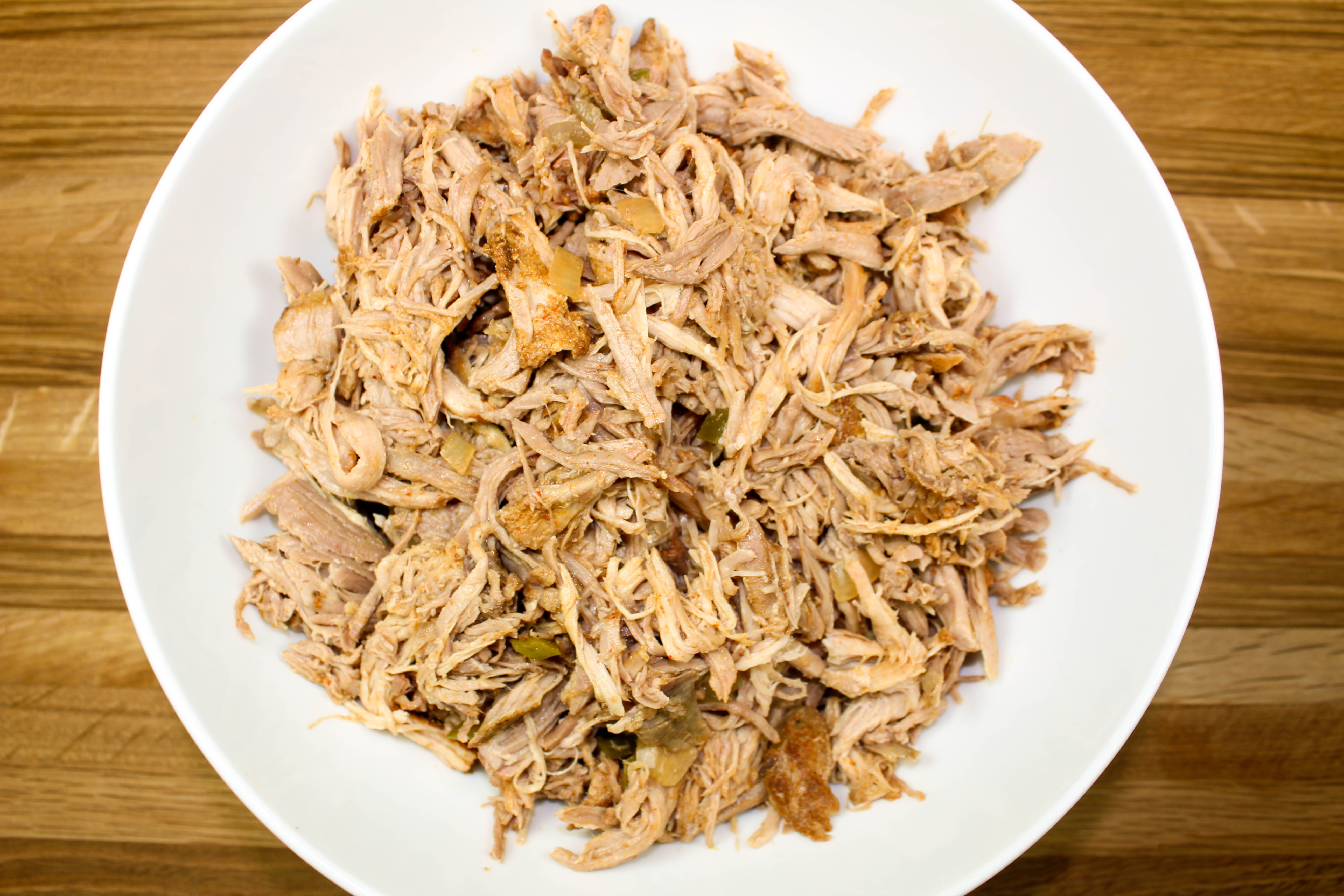 Slow Cooker Mexican Spiced Pulled Pork is perfect for pork inspired recipes like tacos, stews, enchiladas, pizza, and more! Weight Watchers friendly recipe! www.bitesofflavor.com