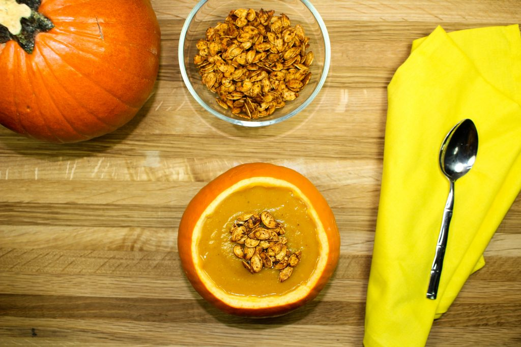 Spicy Pumpkin Soup-Perfect blend of sweet and savory. Creamy pumpkin blended with spices & topped with roasted pumpkin seeds. Healthy, quick to make, & freezer friendly. Weight Watcher friendly (3 SmartPoints)!